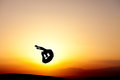 Gymnast jumping in sunset silhouetted Stock Images