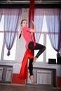 Gymnast performing aerial exercises n Royalty Free Stock Images