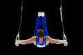 Gymnast Performing On The Rings Royalty Free Stock Photo