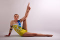 Gymnast yoga girl stretching leg Royalty Free Stock Photo