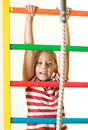 The gymnastic equipment little girl pulls on Royalty Free Stock Images
