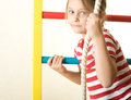 Gymnastic rope little girl climbs Stock Photo