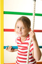 Gymnastic smiling little girl rope climbs Royalty Free Stock Photo