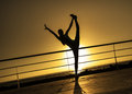 Gymnastic on the sunset young woman do during Stock Image