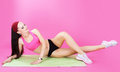 Gymnastics. Abdominal Exercise. Shapely Woman on a Sport Mat Royalty Free Stock Photo