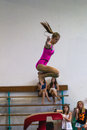 Gymnastics girl beam jump young jumping on the during her routine at the regional competition held at pinetown gym durban south Royalty Free Stock Image