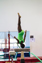 Gymnastics girl beam somersault courage young african on the with doing a in her routine program at the regional competition held Stock Images