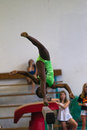 Gymnastics girl beam somersault young african on the doing a in her routine program at the regional competition held at pinetown Royalty Free Stock Photo