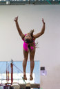 Gymnastics girl somersaults beam exit young on the exiting her routine at the regional competition held at pinetown gym durban Royalty Free Stock Image