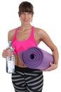 Gymnastics mat fitness woman water bottle at sports workout trai Royalty Free Stock Photo