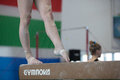 Gymnasts girl feet taped beam close up photo image on the apparatus of girls female ankles strapped from injury or protection in Royalty Free Stock Photography