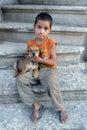 A gypsy boy holds a puppy in Edirne in northern Turkey.