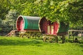 Gypsy caravans two in a field near the trees Royalty Free Stock Photos