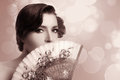 Gypsy girl beauty fashion andalusian woman with stylish fan beautiful carnation in hair and covering half face a spanish fine art Stock Image