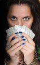 Gypsy woman with fan of cards and mysterious look Stock Photography
