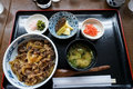Gyudon or beef bowl, a japanese popular dish, in combo set including rice bowl, miso soup, pickle and other side dishes Royalty Free Stock Photo