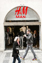 H m man an store with lots of people Stock Images