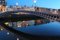 Ha penny bridge dublin at dusk in ireland Royalty Free Stock Photo