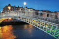 Ha penny bridge in dublin and river liffey at night blue hour Stock Photos