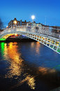 Ha penny bridge in dublin and river liffey at night blue hour Royalty Free Stock Images