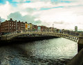 Ha penny bridge famous droichead na life half in dublin city crossing the river liffey and connecting north and south Royalty Free Stock Photos