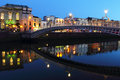 Ha penny bridge at night in dublin and lights liffey river dusk ireland Stock Photo
