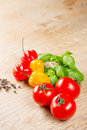 Habanero peppers tomato basilicum Stock Photos