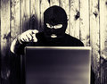 Hacker in a balaclava Royalty Free Stock Photo