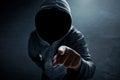 Hacker in dark room Royalty Free Stock Photo