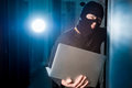 Hacker in a datacenter mask inside Royalty Free Stock Photography