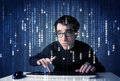 Hacker decoding information from futuristic network technology with white symbols Royalty Free Stock Image