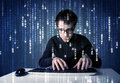 Hacker decoding information from futuristic network technology with white symbols Stock Photography