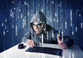 Hacker decoding information from futuristic network technology with white symbols Stock Image