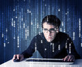 Hacker decoding information from futuristic network technology with white symbols Royalty Free Stock Photos