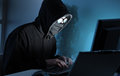 Hacker stealing data from computer young male thief Royalty Free Stock Photo