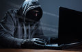 Hacker stealing data from a laptop computer concept for network security identity theft and computer crime Stock Photos
