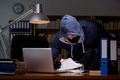 The hacker stealing personal data from home computer
