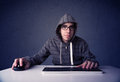 Hacker working with keyboard on blue background and mouse Royalty Free Stock Photo