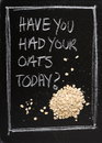 Had your oats today have you hand written on a used blackboard with a pile of porridge alongside as a concept for healthy Royalty Free Stock Photos