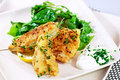 Haddock on wild rocket salad Stock Photo