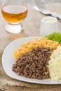 Haggis neeps tatties traditional scottish meal commonly served at burns night served with a dram Stock Images