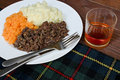 Haggis neeps and tatties traditional scottish with whisky also known as a burns supper Stock Image