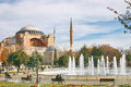 Hagia Sophia byzantine church in Istanbul and fountain in a park Royalty Free Stock Photo