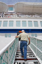 Haifa may cruise ship of mano company israel port a male passenger climbing aboard the ladder Royalty Free Stock Images