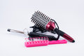 Hair accessories brushes and curling iron Royalty Free Stock Photo