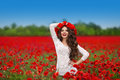 Hair. Beautiful happy smiling teen girl portrait with red flower Royalty Free Stock Photo