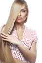 Hair beauty portrait of young beautiful woman with long glossy blond Royalty Free Stock Image