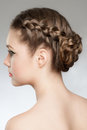 Hair braid portrait of young beautiful woman with blond and hairdo rear view hairstyle with tress Stock Images