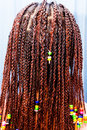 Hair braiding with colorful beads Stock Images