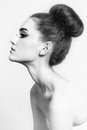 Hair bun black and white shot of young beautiful girl with Royalty Free Stock Photo